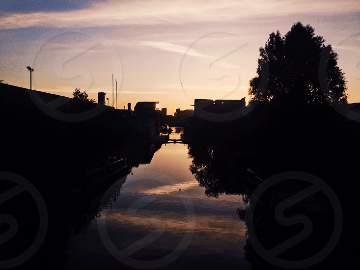 Sunset over the canal in london photo