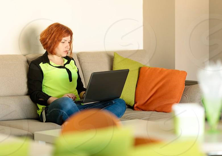millenial sitting at laptop photo