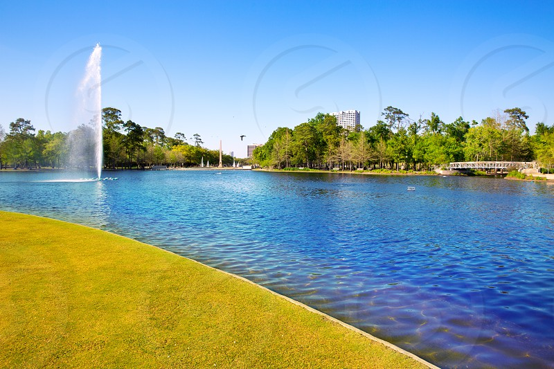 Houston Mc govern lake with spring water and green grass in Texas photo