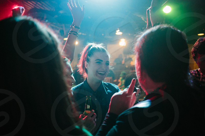 woman in black button down shirt in party photo