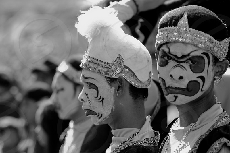masked dancers streets photo