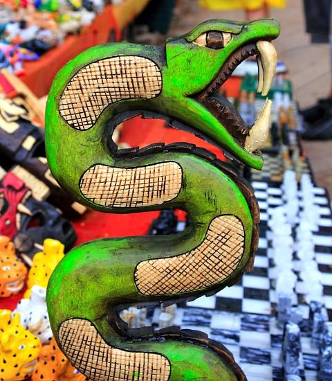 Chichen Itza serpent snake wood colorful handcraft Mayan Mexico Yucatan photo