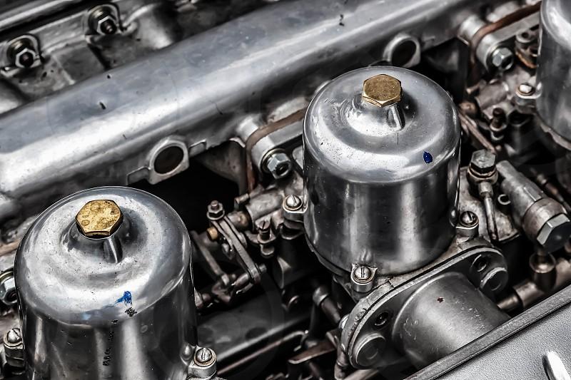 Carburettors under the Bonnet of an Old Jaguar Sports Car photo