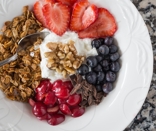 breakfast bowl with fruit yoghurt nuts and granola photo