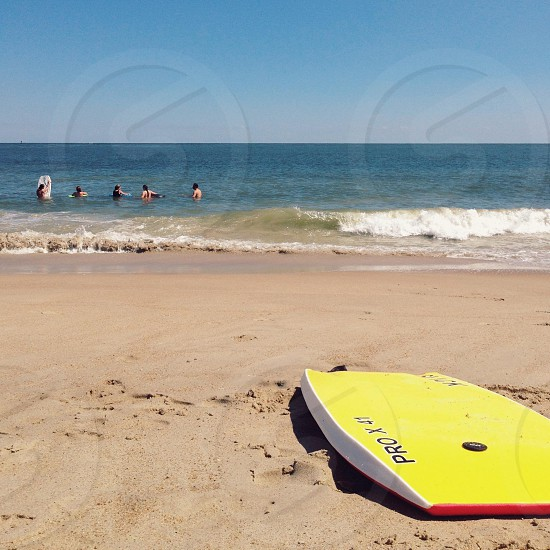Summer bodyboard fun beach friends yellow ocean photo