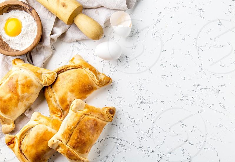 Chilean EMPANADAS DE PINO. Independence day baking concept. Empanadas on white background photo