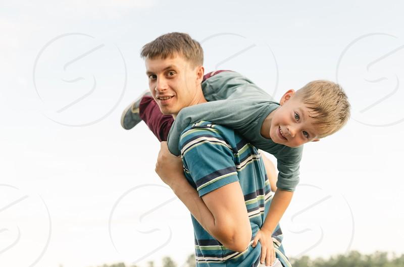 father and son having fun. family dad son boy man with a boy photo