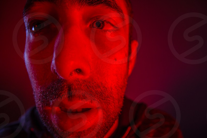 Sweating man looked sick or stoned. Close up headshot portrait of man having fever or drugged him or poisoned him. photo