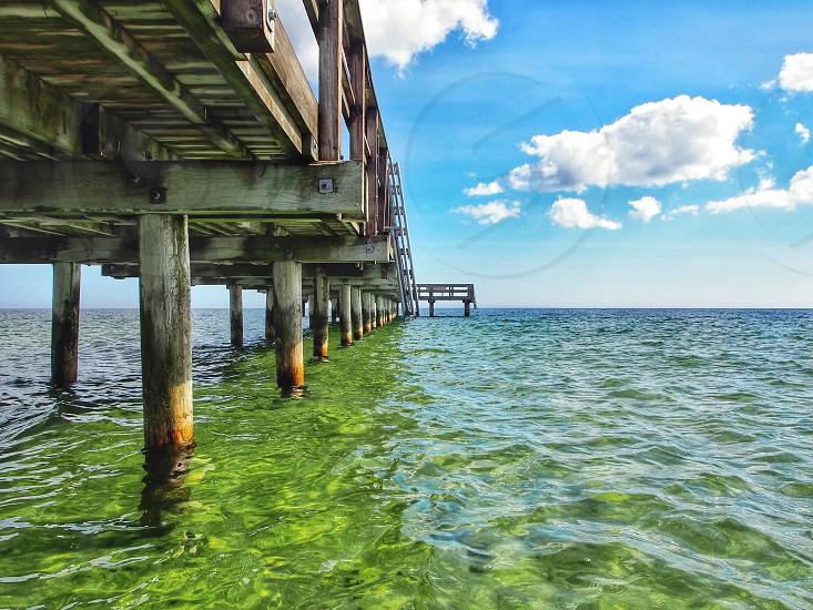 green ocean under bridge photo