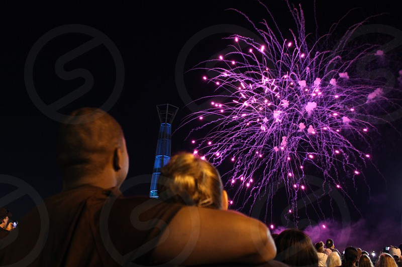 Couple looking toward fireworks. photo