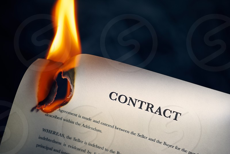 contract paper agreement fire flame loan beginnings black background burn burning burnt business close-up closeup concept copy space corporate debt destruction document finance financial freedom glowing good news heat indoor investment legal lend no people nobody obligation object paperwork sale sales smoke studio photo