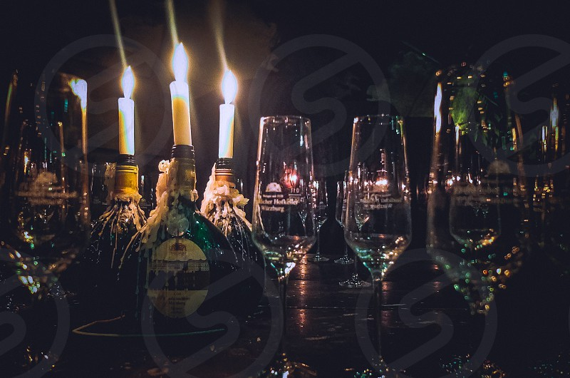 bottle of wine wine cellar candles glasses alcohol photo