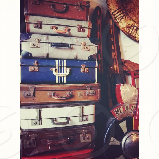 white blue brown and white luggage bags photo
