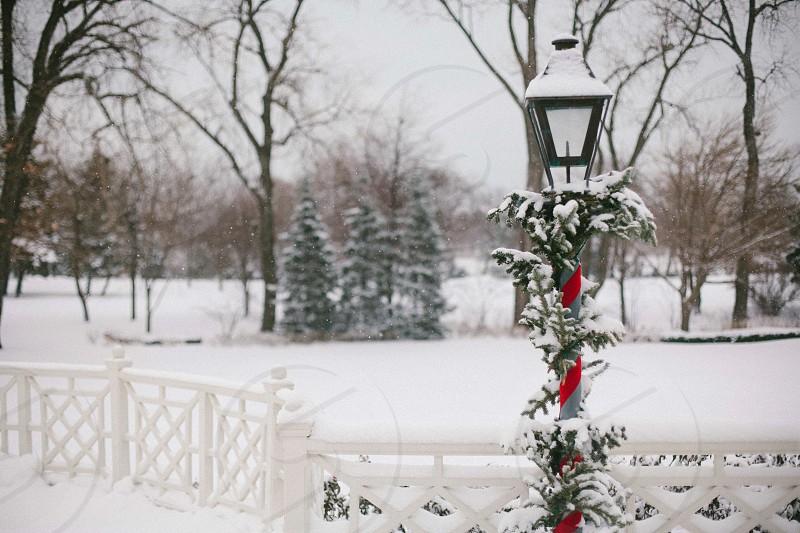 black street pole lamp during snow photo