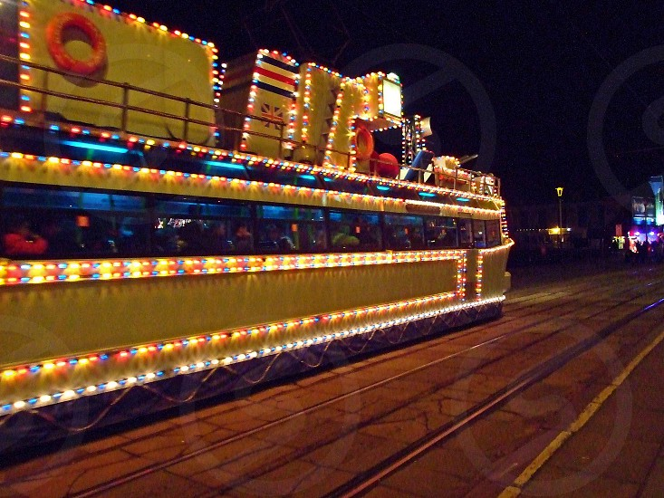 UNITED KINGDOM. England. Blackpool one of the highly decorated tram gliding along the promenade during the annual Blackpool illuminations. photo