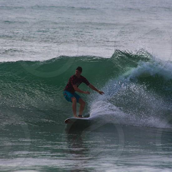 man surfing on wave photo