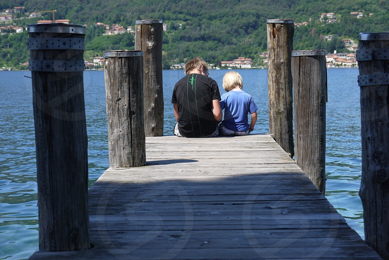two brothers at lago d'orta italy photo