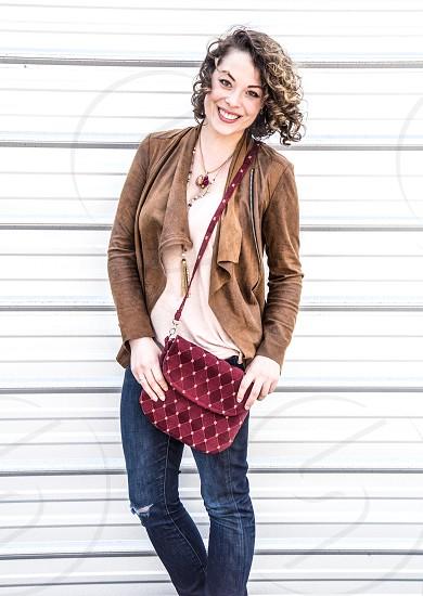 Beautiful young woman models fashionable clothes and handbags.  Fashion.  Clothes. Model. Stylish. photo