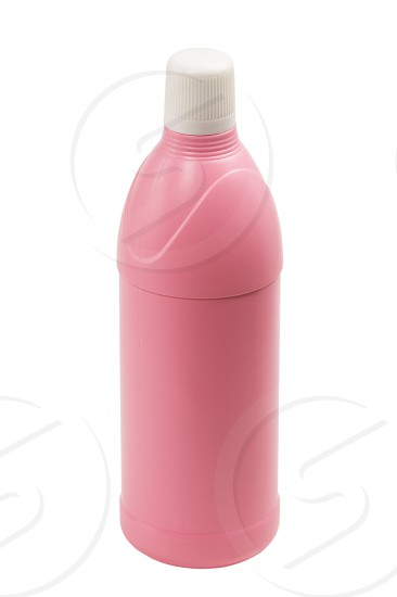 coulored plastic bottle isolated on white background photo
