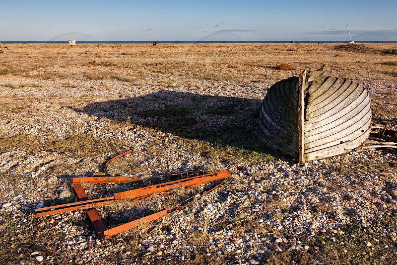 DUNGENESS KENT/UK _ DECEMBER 17 :  Derelict Rowing Boat on Dungeness Beach in Kent on December 17 2008 photo