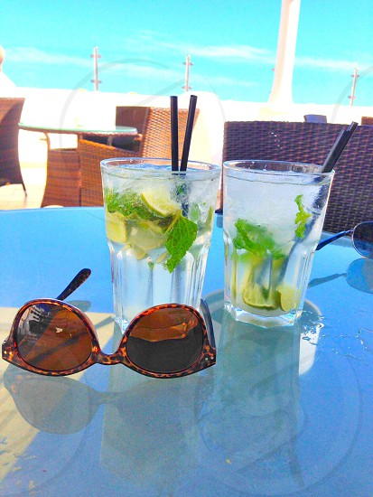 drink glasses and sunglasses on table photo