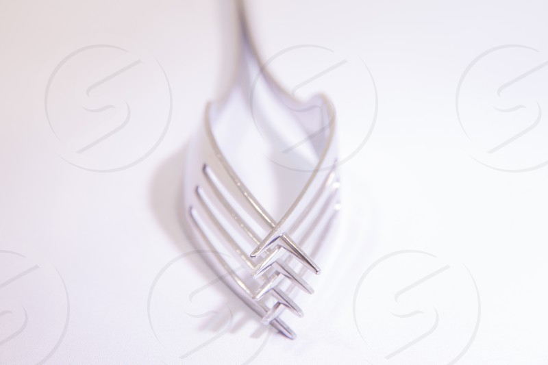 Two Forks  Intertwined High Key Utensils  photo