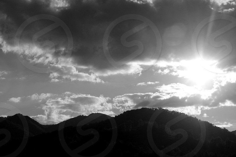 light shadow black and white mountains clouds sky sun photo