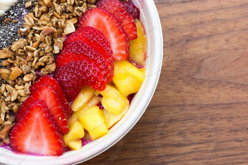 strawberries breakfast mangos chia seeds bowl photo
