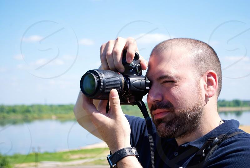 Photo of photographer taking a photo photo