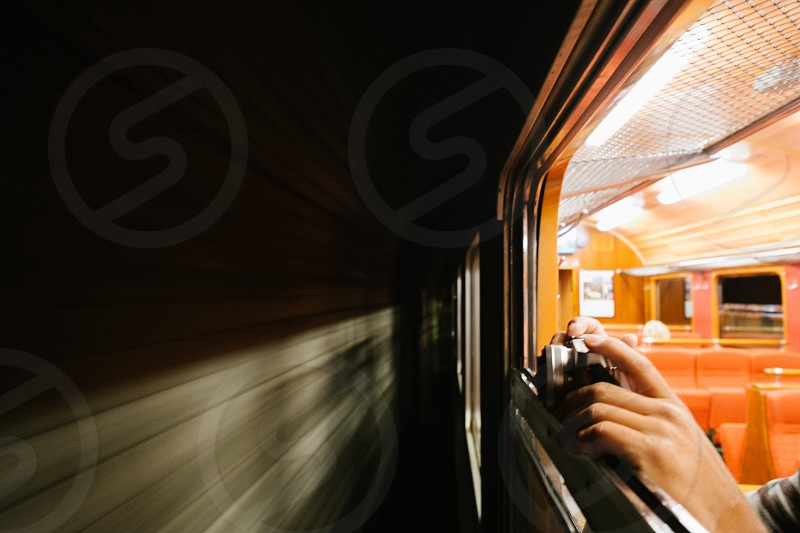 man taking photo of another bypassing train photo