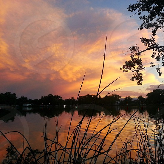 Beautiful sunset overlooking the lake with the storm on it's way. photo