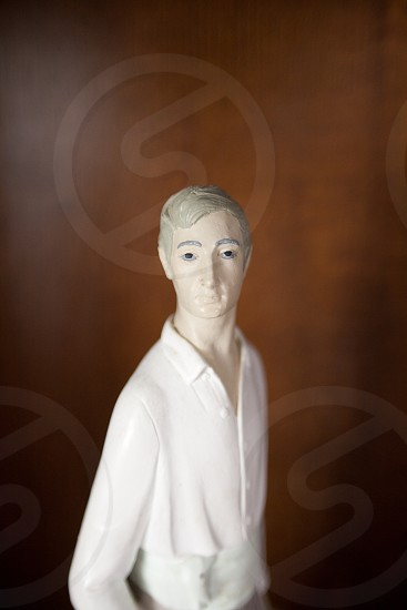 man in white dress shirt figurine photo
