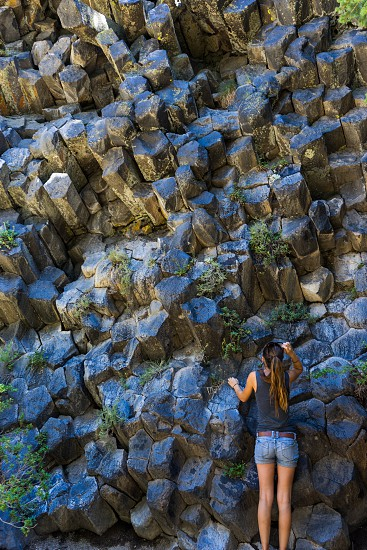"""It doesn't get any more pure """"geometry"""" than this. Geo-metry from the Greek words 'geo' meaning earth and 'metria' meaning measure. Columnar basalt at The Devil's Postpile near Mammoth California form a wall of hexagonal protrusions.  photo"""