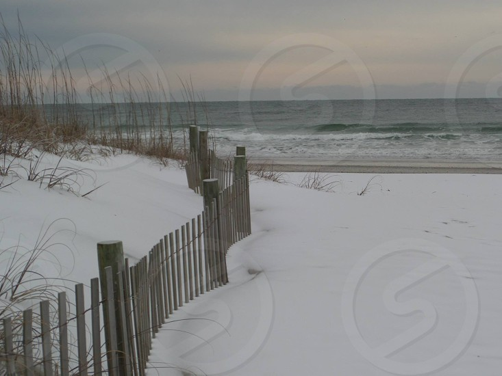 Wrightsville Beach on a rare snow day. Surf sand & snow is not the typical combination! photo