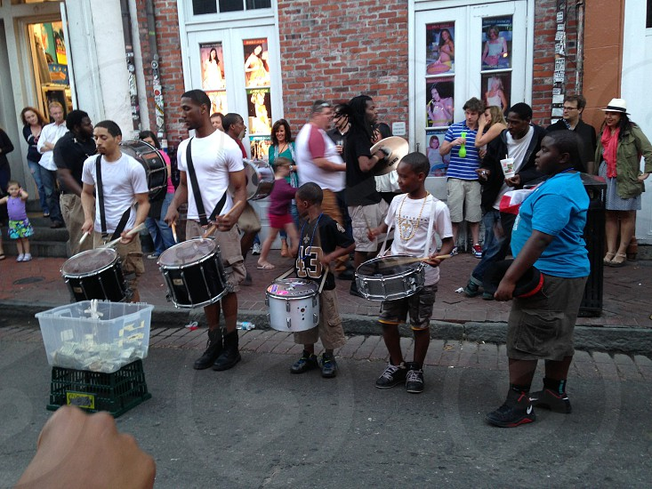 group of people playing drum on street photo