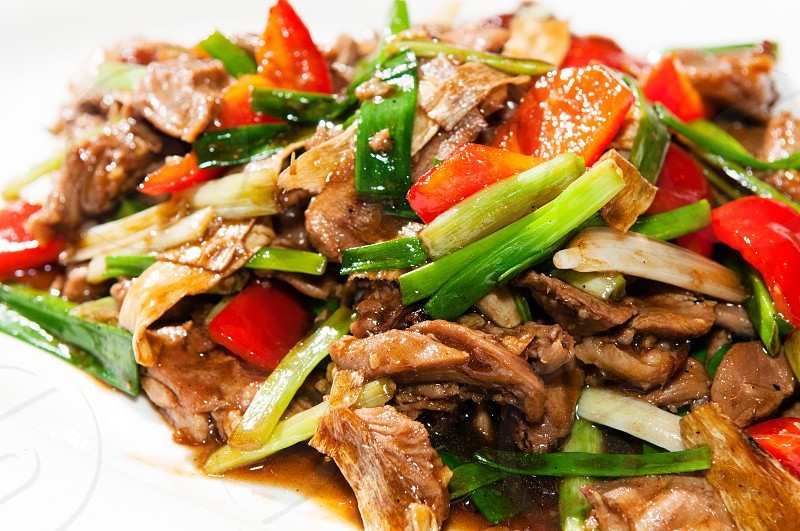 Stir fry duck with ginger onion and capsicum photo