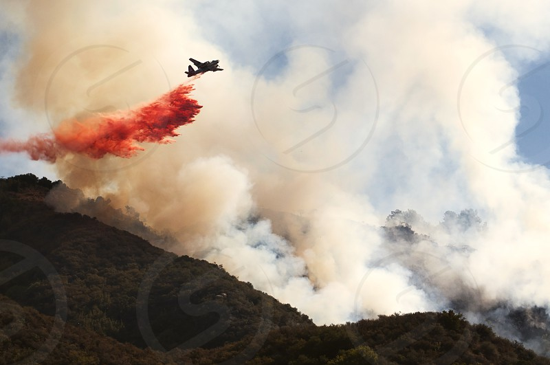 Air units rush to contain the Lookout Fire in Santa Barbara CA USA.  wildfire; fire; california; santa barbara; lookout; 154; san marcos pass; forest fire; brush; smoke; airplane; environment; drought; rescue  No Model Release no recognizable people or property. photo