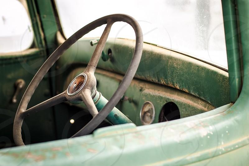 Steering wheel of an old green vintage car. steering wheel vintage car old green photo