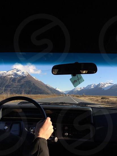 #driving #window #roadtrip #road #scenic #traveling #mountains #alaska #view photo