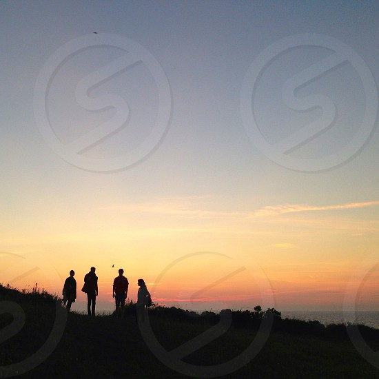sunset with people silhouette photo