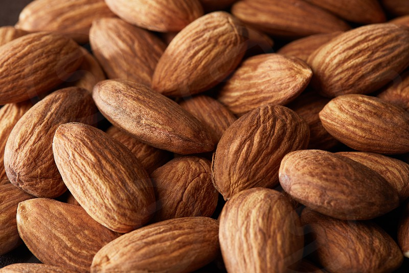 The cleared handful of almonds nut close up. Food background photo