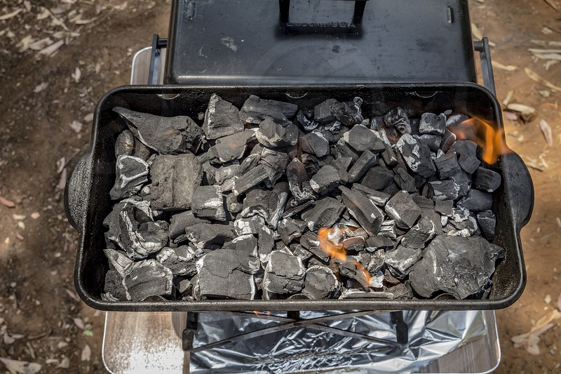 Coals are burned in a BBQ grill. Top view. photo