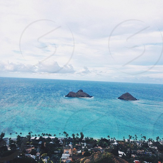 blue body of water under white clouds photo