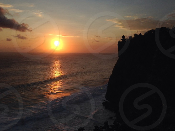Sunset in tanah Lot Bali. photo