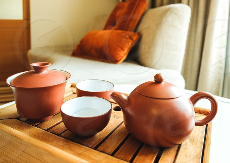 The oriental tea set on a bamboo tray in a living room. photo