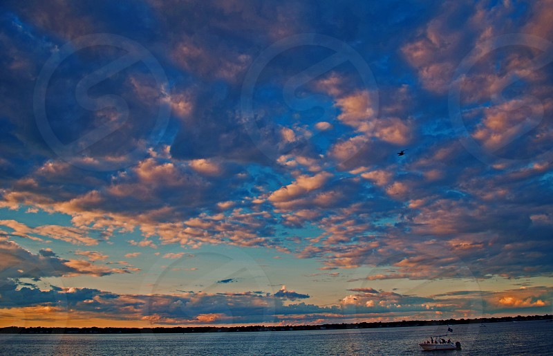 sunset beach clouds boat water photo