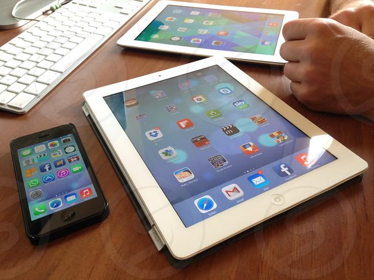 white ipad iphone and ipad mini on top of desk photo