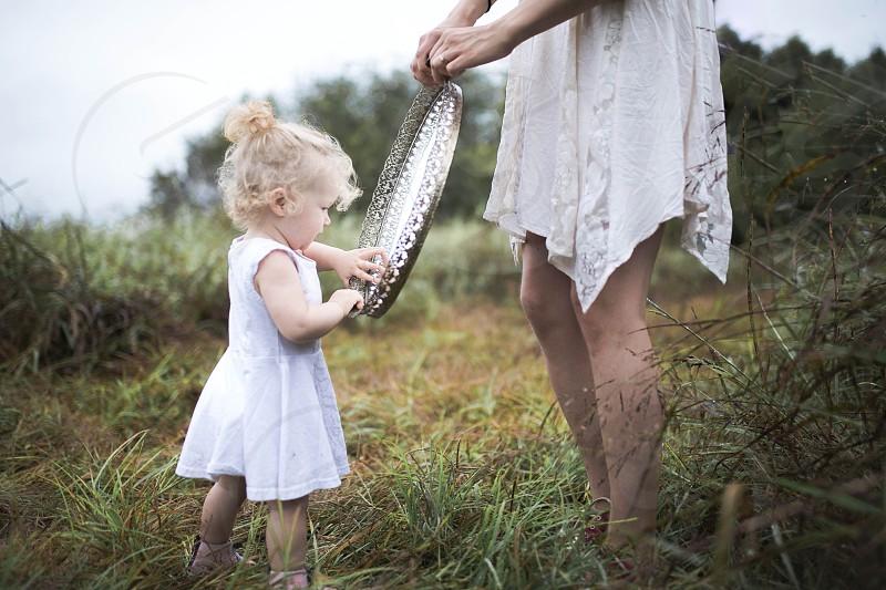 mother daughter child toddler girl dress white nature greenery lush love  photo