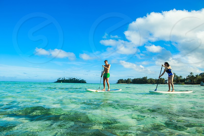 Standup Paddle boarding on vacation photo