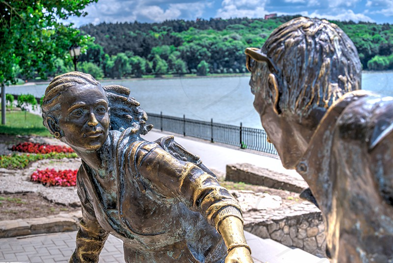 Chisinau Moldova – 06.28.2019. Sculpture by the Valea Morilor Lake in Chisinau Moldova on a sunny summer day photo